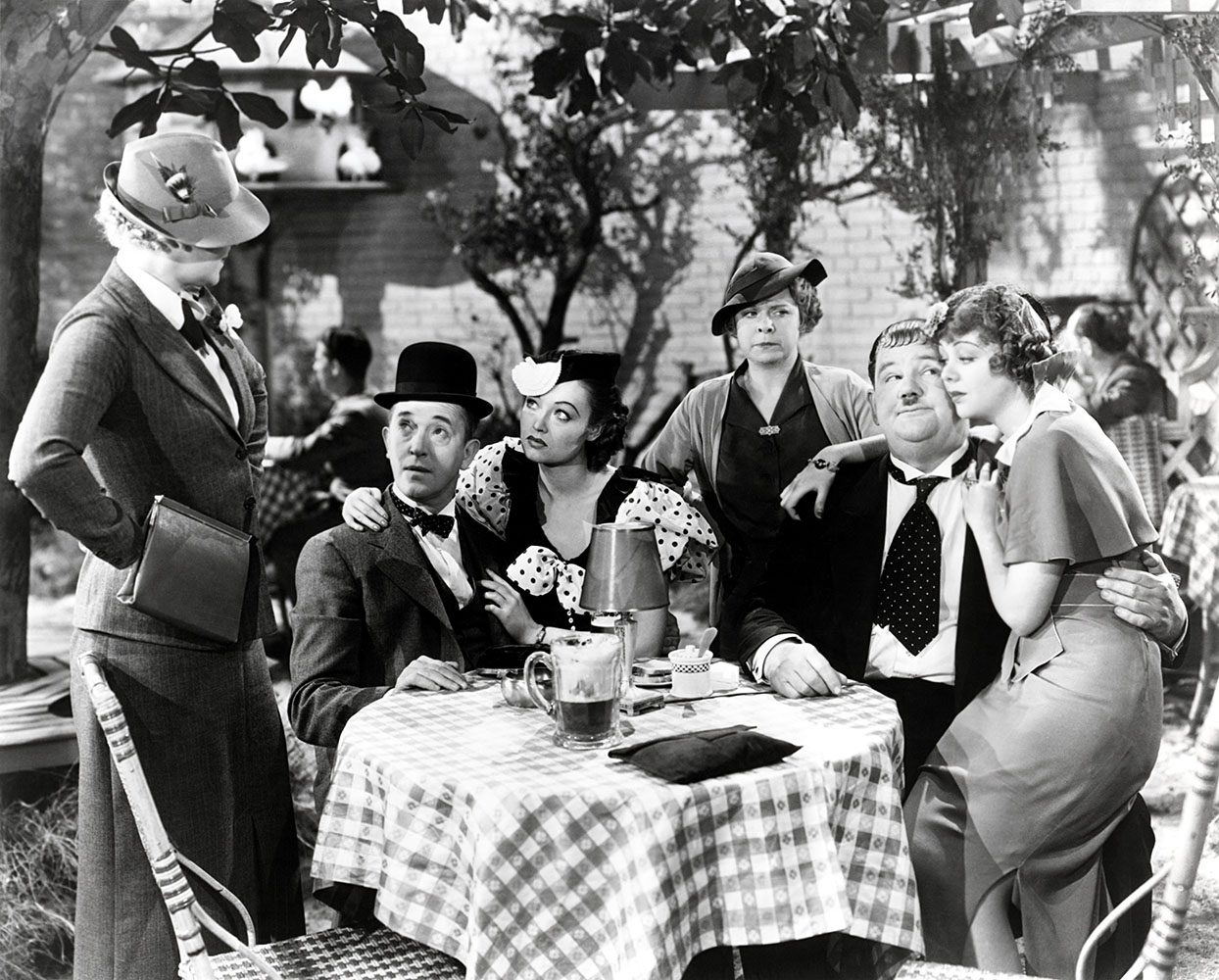 Betty Healy, Stan Laurel, Lona Andre, Daphne Pollard, Oliver Hardy and Iris Adrian - 1936